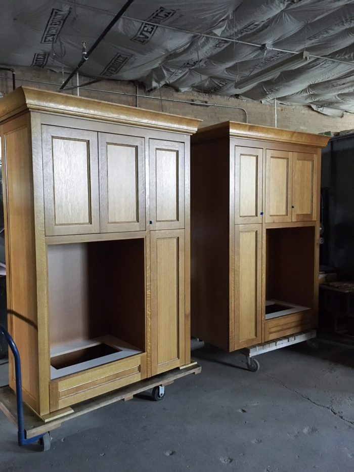This set of cabinets will go on to house a mail center for a condo building lobby.  The large opening will house  traditional aluminum mail box lockers. Quartersawn white oak with custom stain.