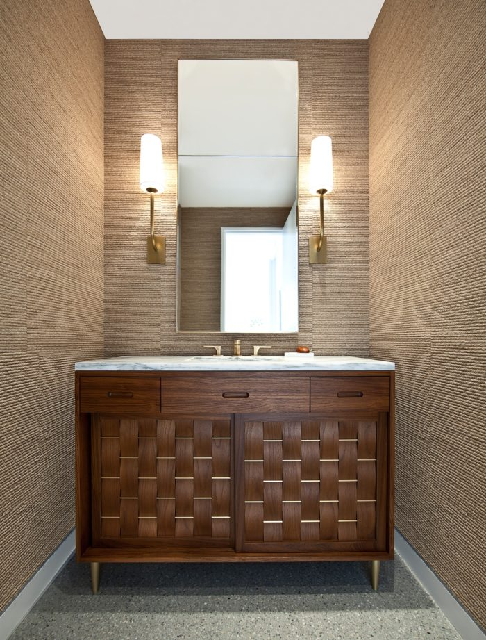 We made this extraordinary bathroom vanity. Basket weave doors in solid walnut and brass.  Vinci Hamp Architects